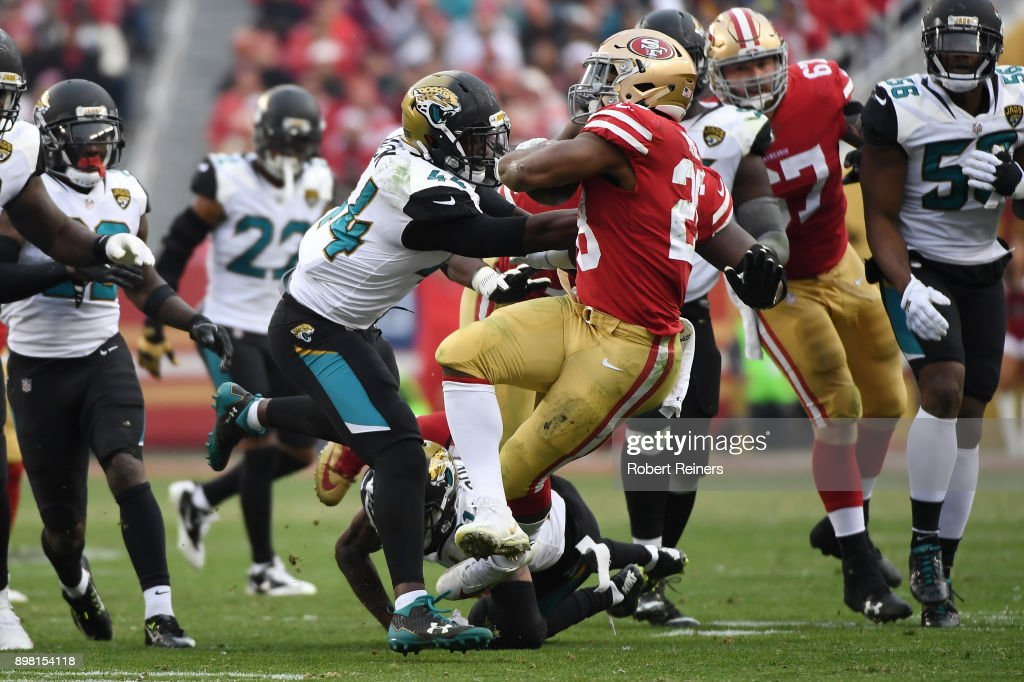 Matt Breida #22 of the San Francisco 49ers rushes with the ball against the Jacksonville Jaguars during their NFL game at Levi's Stadium on December 24, 2017 in Santa Clara, California.