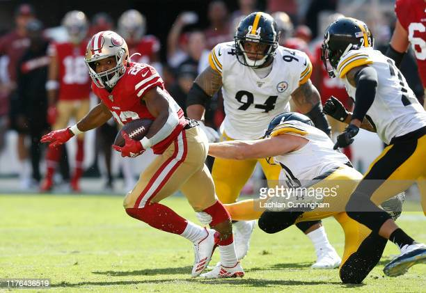 Matt Breida of the San Francisco 49ers spins away from a tackle by T.J. Watt of the Pittsburgh Steelers in the third quarter at Levi's Stadium on...