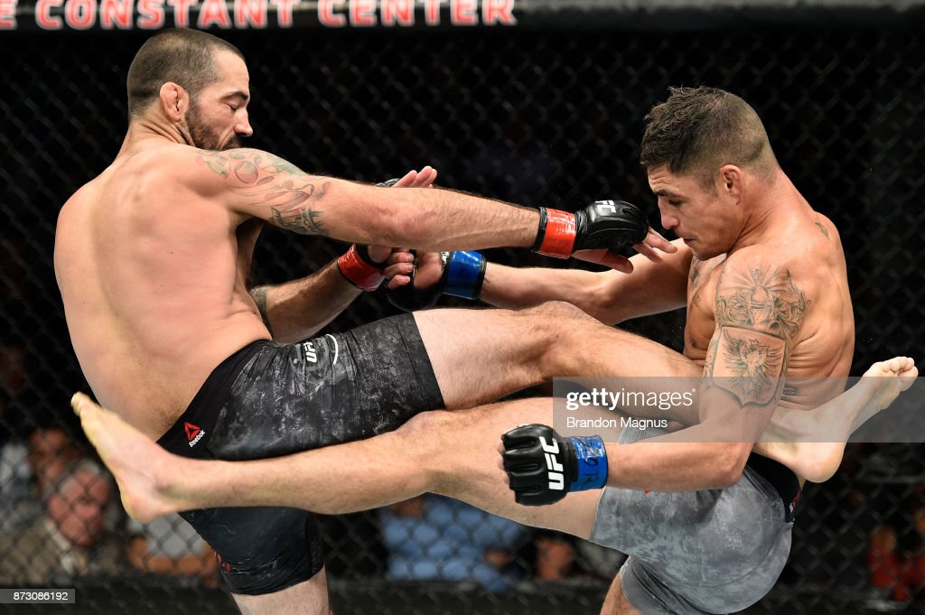 Matt Brown and Diego Sanchez exchange kicks in their welterweight bout during the UFC Fight Night event inside the Ted Constant Convention Center on November 11, 2017 in Norfolk, Virginia.