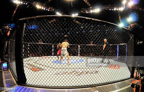 Matt Brown and John Howard touch gloves at the center of the octagon at the start of a welterweight bout at UFC on Versus 4 Sunday June 26, 2011 at...