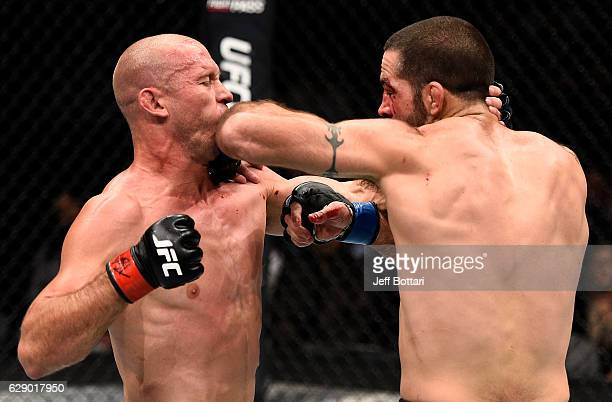 Matt Brown elbows Donald Cerrone in their welterweight bout during the UFC 206 event inside the Air Canada Centre on December 10, 2016 in Toronto,...