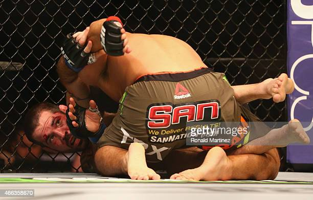 Matt Brown fights with Johny Hendricks in the Welterweight bout during the UFC 185 event at American Airlines Center on March 14 2015 in Dallas Texas