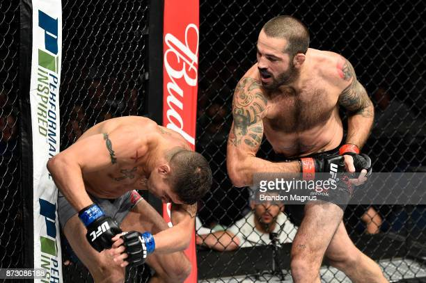 Matt Brown throws an elbow against Diego Sanchez in their welterweight bout during the UFC Fight Night event inside the Ted Constant Convention...