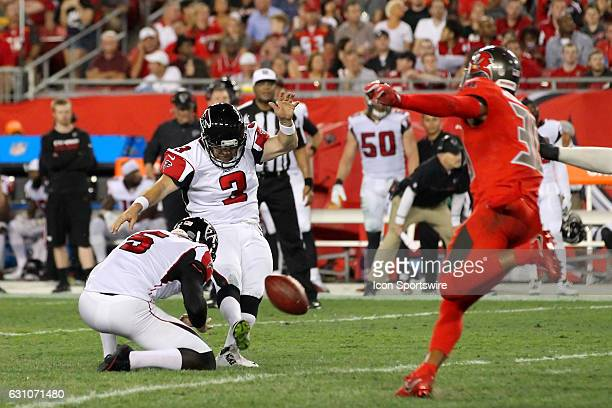 Matt Bryant of the Falcons kicks a field goal from the hold of Matt Bosher during the NFL game between the NFC South opponent Atlanta Falcons and...