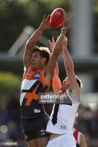 Matt Buntine of the Giants goes up for the mark during the round seven AFL match between the Greater Western Sydney Giants and the St Kilda Saints at...