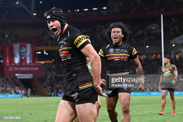 Matt Burton of the Panthers celebrates after scoring a try during the 2021 NRL Grand Final match between the Penrith Panthers and the South Sydney...