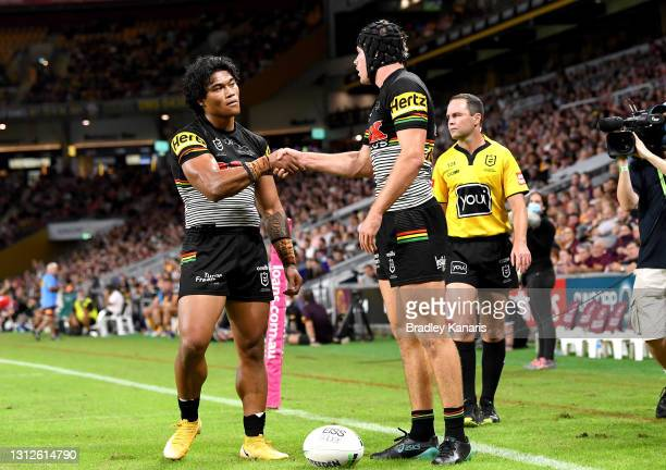 Matt Burton of the Panthers celebrates with team mate Brian To'o after scoring a try during the round six NRL match between the Brisbane Broncos and...