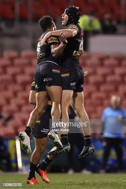 Matt Burton of the Panthers celebrates with team mates after kicking a field-goal during the round 16 NRL match between the Penrith Panthers and the...