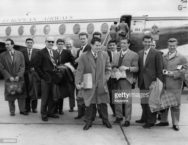Matt Busby at London airport with members of the Manchester United football team This was the team's first flight together since the Munich air...