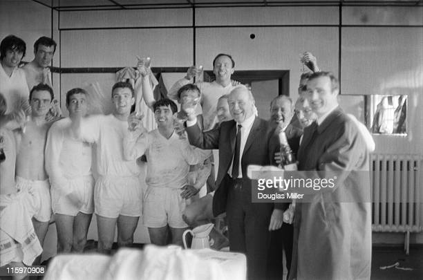 Matt Busby manager of Manchester United celebrates his team's victory in their dressing room after they beat West Ham 61 at Upton Park to become the...