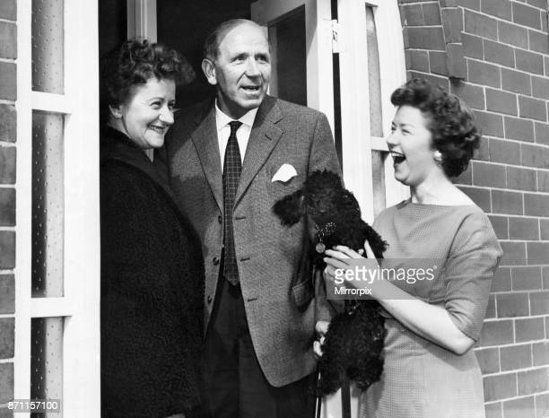Matt Busby Manchester United Manager delighted to be back home in Charlton after Munich Air Disaster pictured with wife Jean and daughter Sheena...