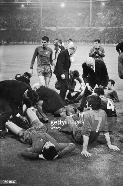 Matt Busby the manager of Manchester United encouraging his players including George Best as they prepare for extratime in the European Cup final...