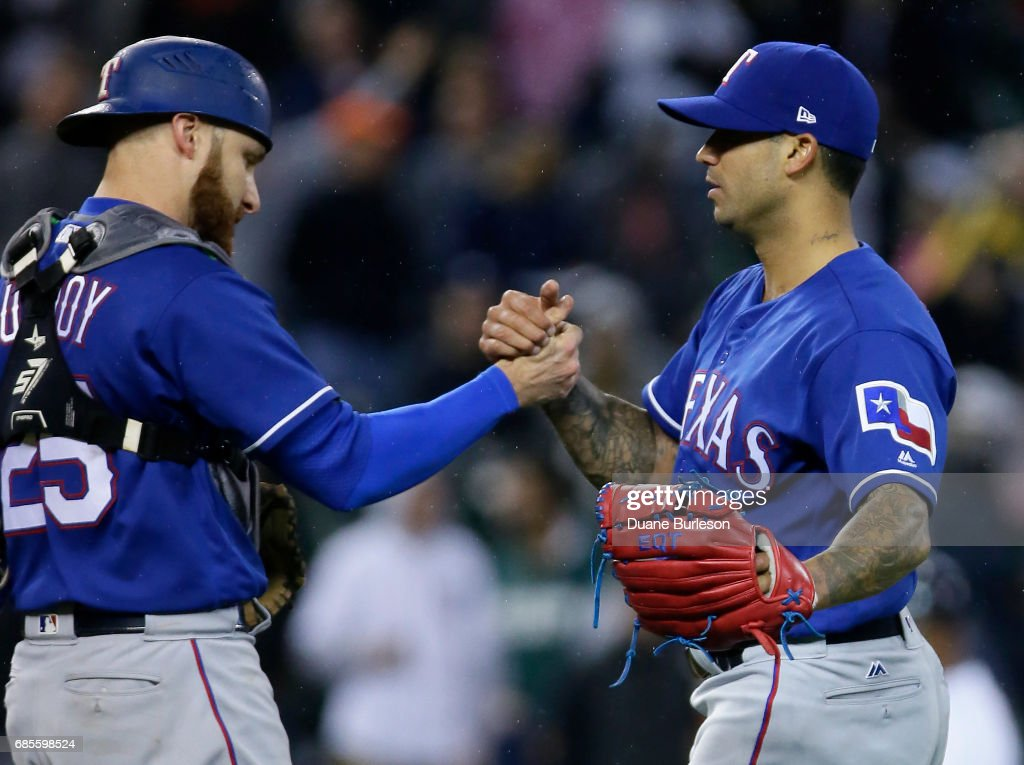 Matt Bush #51 of the Texas Rangers celebrates with catcher Jonathan Lucroy #25 of the Texas Rangers after a 5-3 win over the Detroit Tigers at Comerica Park on May 19, 2017 in Detroit, Michigan.
