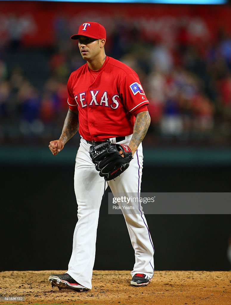 Matt Bush #51 of the Texas Rangers clinches his fist after closing out the game against the Oakland Athletics for the win at Globe Life Park in Arlington on August 17, 2016 in Arlington, Texas.
