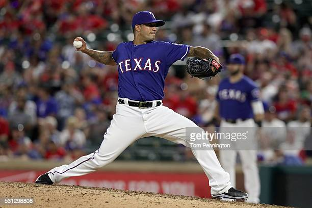 Matt Bush of the Texas Rangers throws his first Major League pitch against Josh Donaldson of the Toronto Blue Jays in the top outfield the ninth...