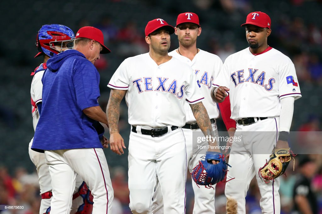 Matt Bush #51 of the Texas Rangers walks off the mound after being pulled from the game against the Seattle Mariners in the top of the seventh inning at Globe Life Park in Arlington on September 13, 2017 in Arlington, Texas.