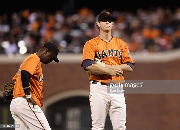 Matt Cain and Edgar Renteria of the San Francisco Giants wait for manager Bruce Bochy to come to the mound to take Cain out of their game against the...