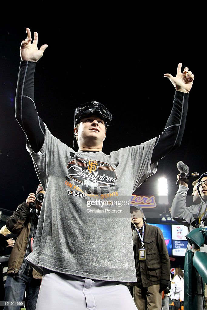 Matt Cain #18 of the San Francisco Giants celebrates after defeating the Detroit Tigers to win Game Four of the Major League Baseball World Series at Comerica Park on October 28, 2012 in Detroit, Michigan. The San Francisco Giants defeated the Detroit Tigers 4-3 in the tenth inning to win the World Series in 4 straight games.