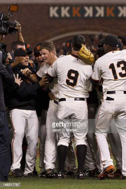 Matt Cain of the San Francisco Giants is congratulated by teammates after the game against the Houston Astros at ATT Park on June 13 2012 in San...