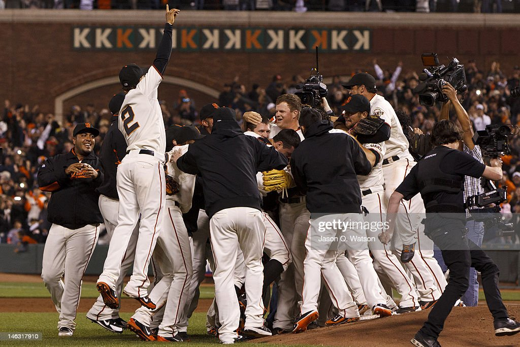 Matt Cain #18 of the San Francisco Giants (center) is congratulated by teammates after the game against the Houston Astros at AT&T Park on June 13, 2012 in San Francisco, California. Cain pitched a perfect game as the San Francisco Giants defeated the Houston Astros 10-0.