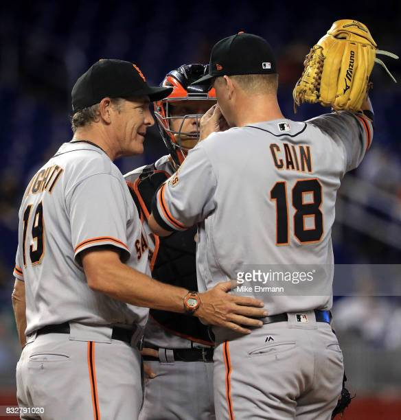 Matt Cain of the San Francisco Giants talks with pitching coach Dave Righetti during a game against the Miami Marlins at Marlins Park on August 16...