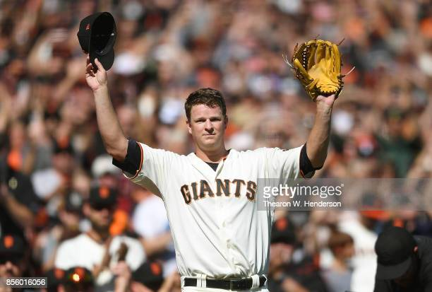 Matt Cain of the San Francisco Giants waves to the fans showing gratitude leaving the game after the top of the fourth inning against the San Diego...
