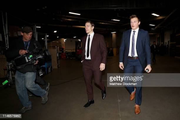 Matt Calvert and Cale Makar of the Colorado Avalanche arrive for their game against the San Jose Sharks during Game Four of the Western Conference...