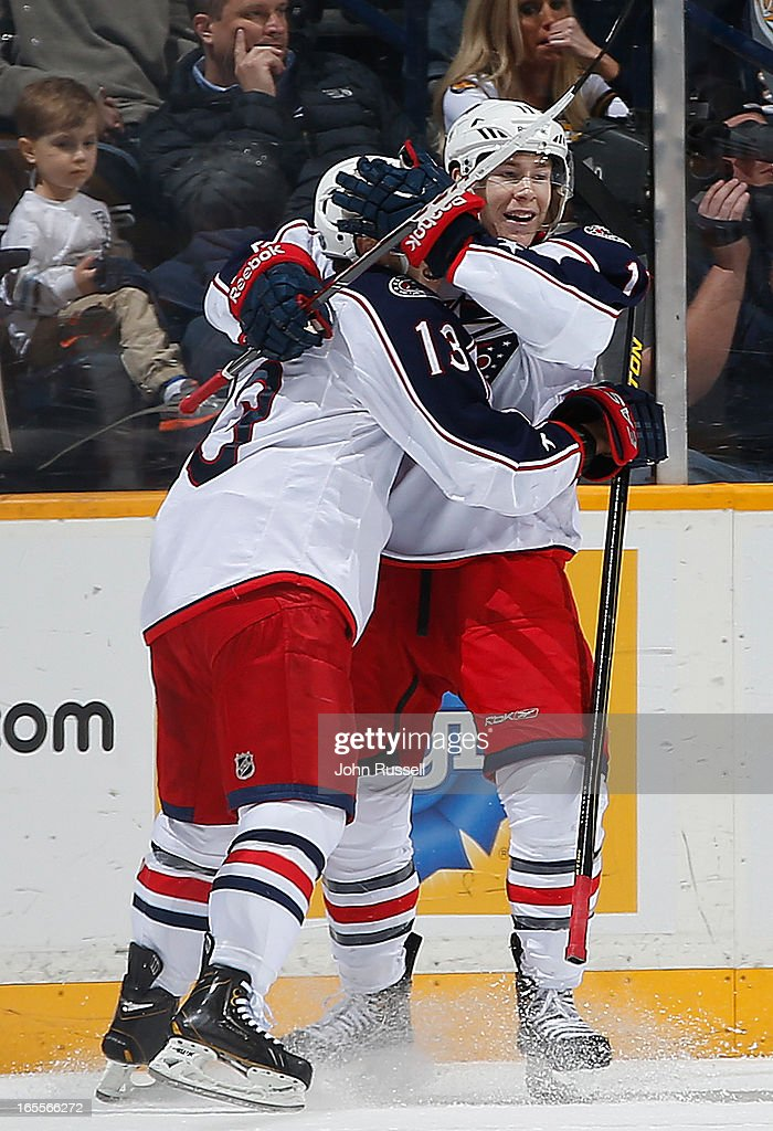 Matt Calvert #11 celebrates his goal with Cam Atkinson #13 of the Columbus Blue Jackets against the Nashville Predators during an NHL game at the Bridgestone Arena on April 4, 2013 in Nashville, Tennessee.