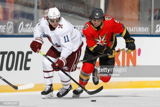 Matt Calvert of the Colorado Avalanche and Cody Glass of the Vegas Golden Knights skate with the puck during the 'NHL Outdoors At Lake Tahoe' at the...