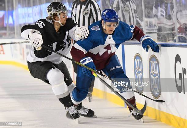 Matt Calvert of the Colorado Avalanche is pressured by Kurtis MacDermid of the Los Angeles Kings during the second period of the 2020 NHL Stadium...
