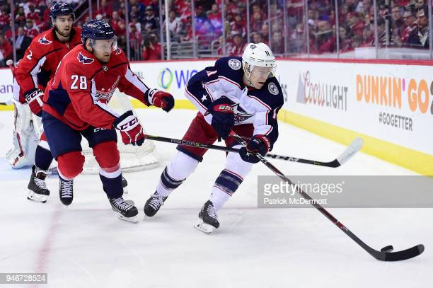 Matt Calvert of the Columbus Blue Jackets and Jakub Jerabek of the Washington Capitals battle for the puck in overtime in Game Two of the Eastern...
