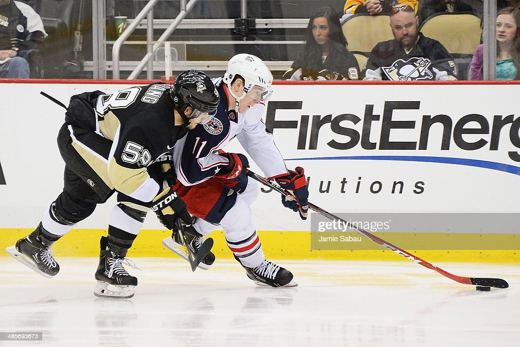Matt Calvert #11 of the Columbus Blue Jackets carries the puck in to the offensive zone with Kris Letang #58 of the Pittsburgh Penguins defending moments before scoring the game-winning goal in the second overtime in Game Two of the First Round of the 2014 NHL Stanley Cup Playoffs on April 19, 2014 at CONSOL Energy Center in Pittsburgh, Pennsylvania. Columbus defeated Pittsburgh 4-3 for their franchise first playoff win.