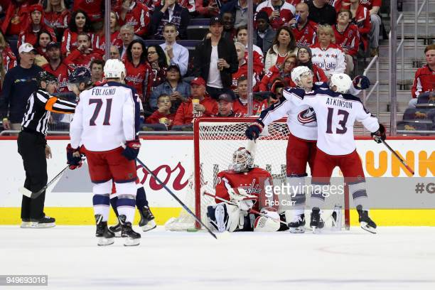 Matt Calvert of the Columbus Blue Jackets celebrates with Cam Atkinson after scoring a second period goal on Braden Holtby of the Washington Capitals...