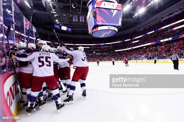 Matt Calvert of the Columbus Blue Jackets celebrates with his teammates after scoring the gamewinning goal in overtime against the Washington...