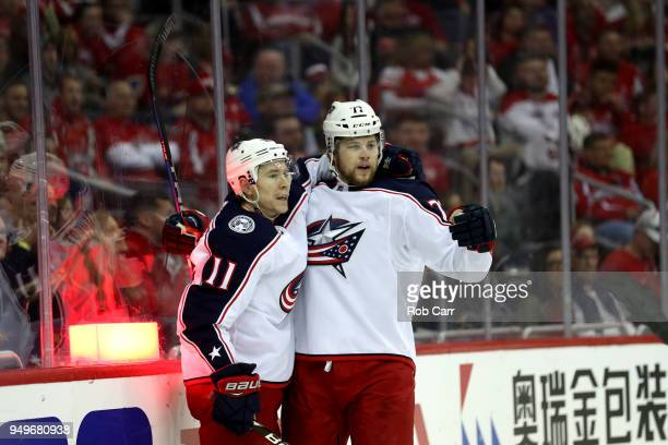 Matt Calvert of the Columbus Blue Jackets celebrates with Josh Anderson after scoring a first period goal against the Washington Capitals during Game...