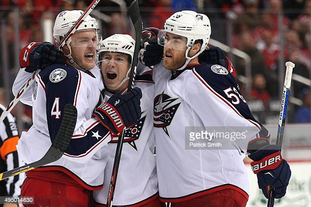 Matt Calvert of the Columbus Blue Jackets celebrates with teammates after scoring a goal in the third period against the Washington Capitals at...