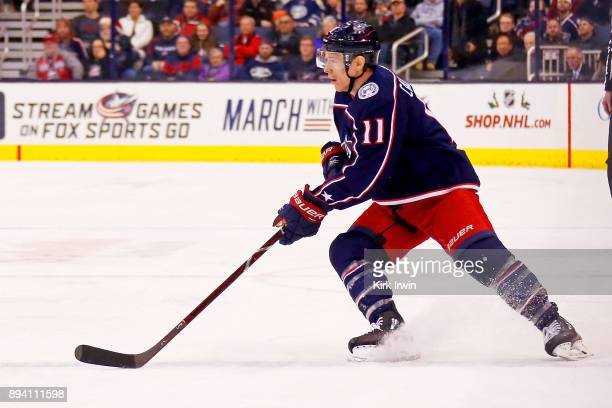 Matt Calvert of the Columbus Blue Jackets controls the puck during the game against the Edmonton Oilers on December 12 2017 at Nationwide Arena in...