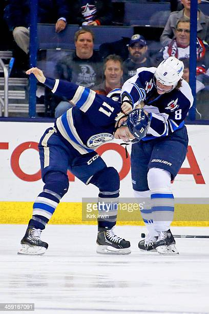 Matt Calvert of the Columbus Blue Jackets fights with Jacob Trouba of the Winnipeg Jets on December 16 2013 at Nationwide Arena in Columbus Ohio