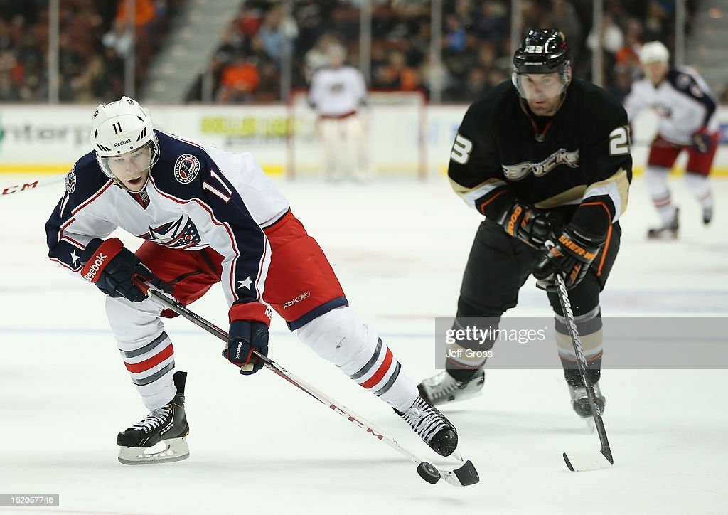 Matt Calvert #11 of the Columbus Blue Jackets is pursued by Francois Beauchemin #23 of the Anaheim Ducks for the puck in the second period at Honda Center on February 18, 2013 in Anaheim, California. The Ducks defeated the Blue Jackets 3-2.