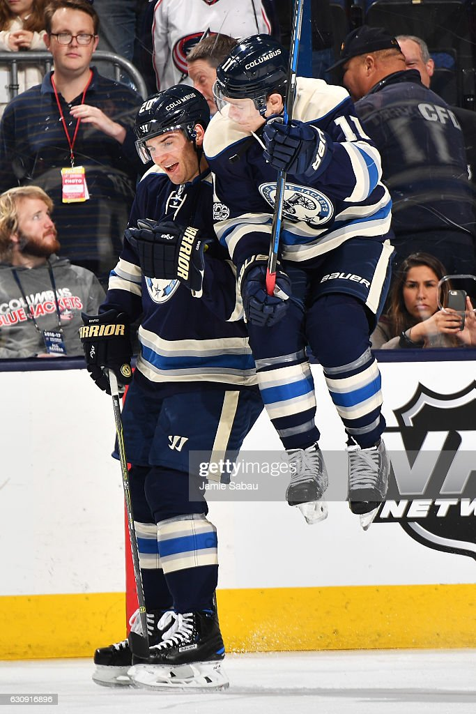 Matt Calvert #11 of the Columbus Blue Jackets jumps into Brandon Saad #20 of the Columbus Blue Jackets during pregame warmups prior to a game against the Edmonton Oilers on January 3, 2017 at Nationwide Arena in Columbus, Ohio.