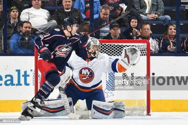 Matt Calvert of the Columbus Blue Jackets skates in front of goaltender Thomas Greiss of the New York Islanders on December 14 2017 at Nationwide...