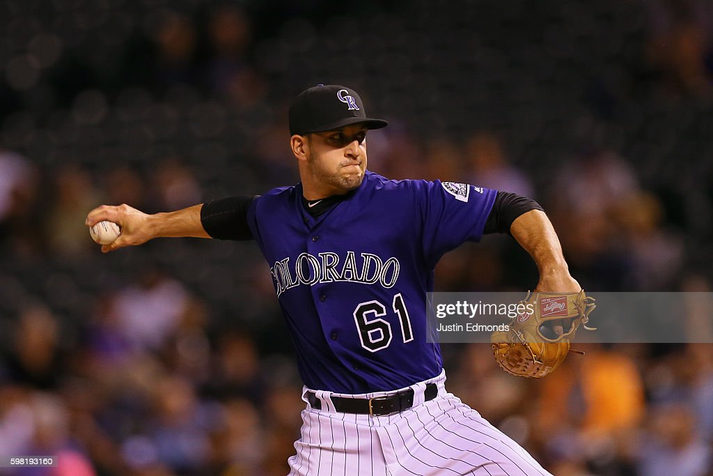 Matt Carasiti #61 of the Colorado Rockies delivers to home plate during the eighth inning against the Los Angeles Dodgers at Coors Field on August 31, 2016 in Denver, Colorado. The Dodgers defeated the Rockies 10-8 to avoid the series sweep.