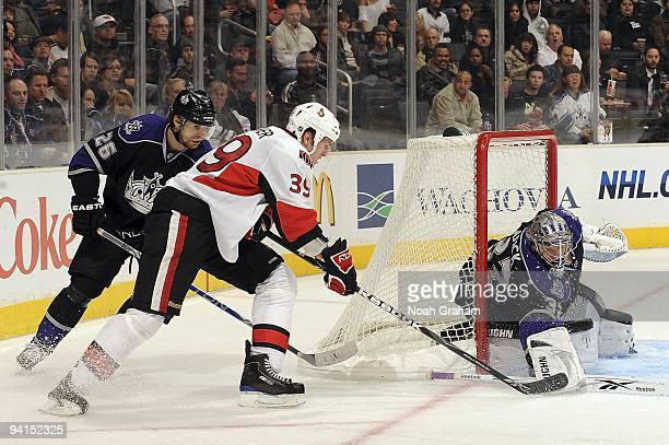 Matt Carkner of the Ottawa Senators attempts to score against Jonathan Quick of the Los Angeles Kings during the game on December 3, 2009 at Staples...