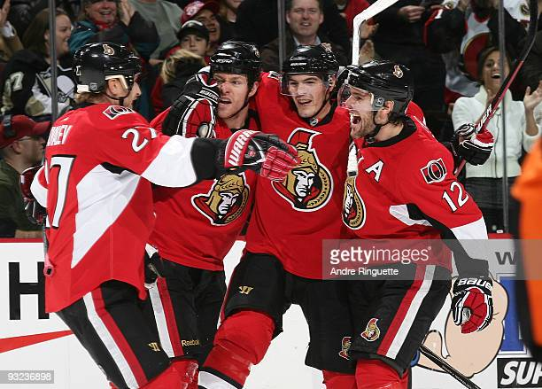 Matt Carkner of the Ottawa Senators celebrates his first period goal against the Pittsburgh Penguins with teammates Alexei Kovalev Alexandre Picard...
