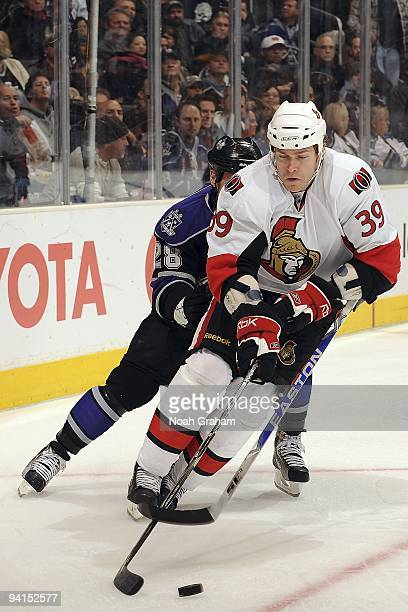 Matt Carkner of the Ottawa Senators controls the puck against Jarret Stoll of the Los Angeles Kings during the game on December 3, 2009 at Staples...