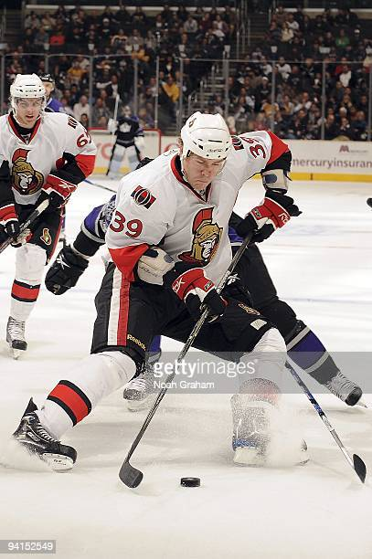 Matt Carkner of the Ottawa Senators controls the puck against the Los Angeles Kings during the game on December 3, 2009 at Staples Center in Los...