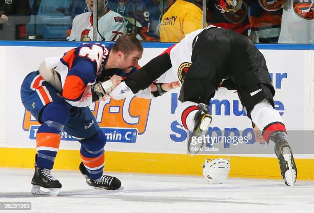 Matt Carkner of the Ottawa Senators gets airborne in a fight with Trevor Gillies of the New York Islanders on April 3, 2010 at Nassau Coliseum in...