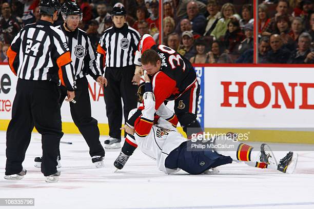 Matt Carkner of the Ottawa Senators takes down Darcy Hordichuk of the Florida Panthers in a fight during a game at Scotiabank Place on October 28...
