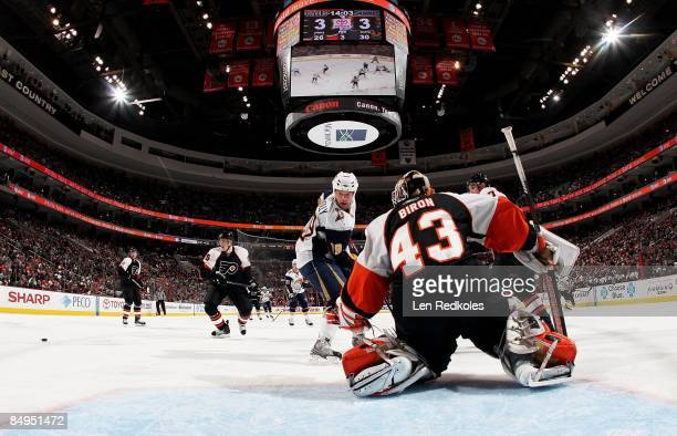 Matt Carle and Martin Biron of the Philadelphia Flyers stop a scoring attempt against Tim Connolly of the Buffalo Sabres on February 19 2009 at the...