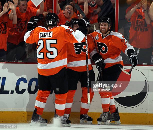 Matt Carle Danny Briere and Claude Giroux of the Philadelphia Flyers celebrate after Briere scored a goal in the first period against the Chicago...